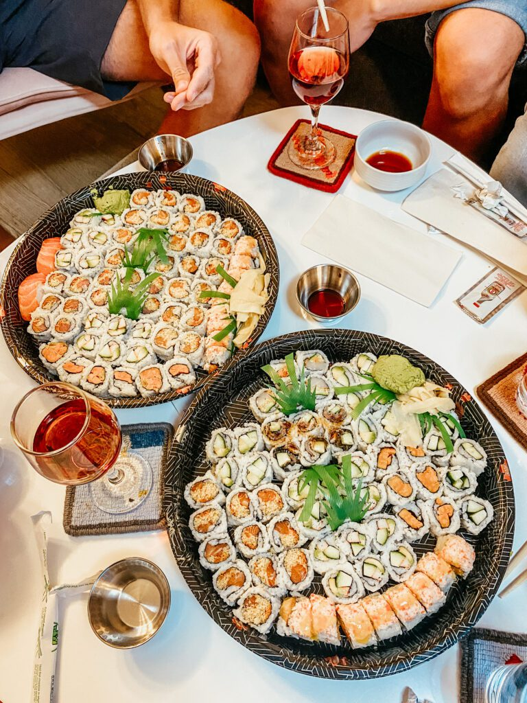 Two platters of maki sushi rolls - a delicious dinner of budget-friendly bites for the whole squad.