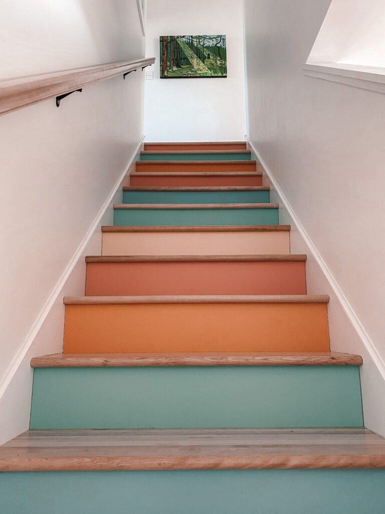A colourful staircase located in the main house at this luxury staycation.