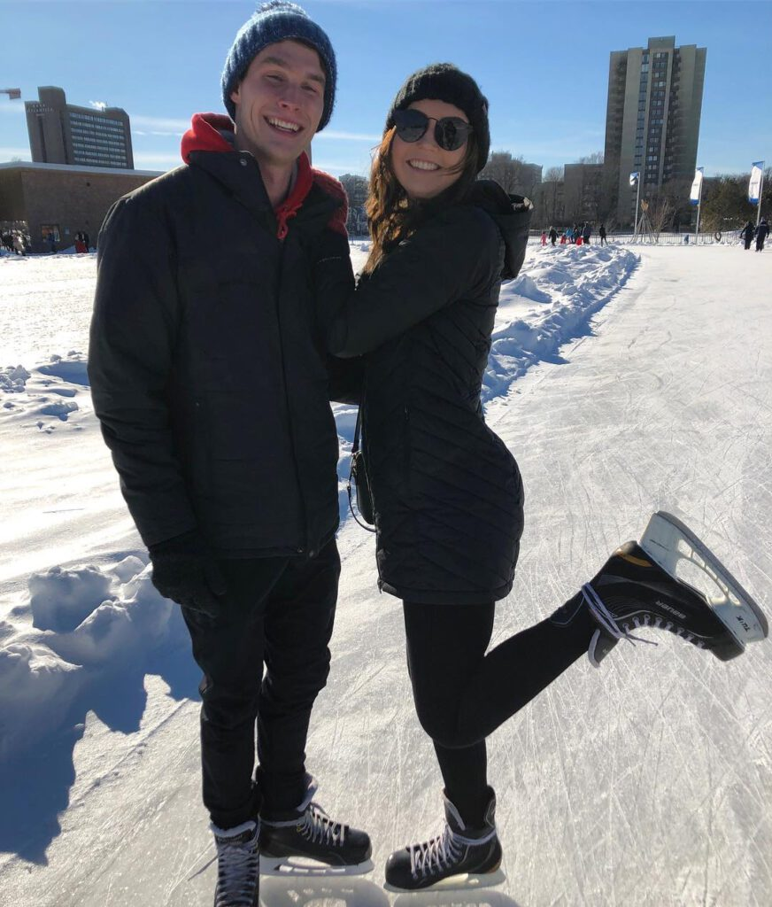 A man and woman smiling while skating at the Emera Oval - a top active date idea spot in Halifax.