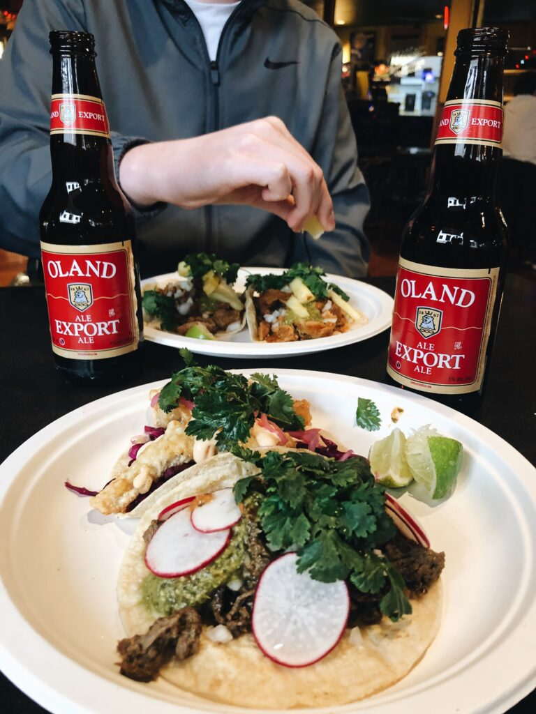 A meal of budget-friendly bites consisting on tacos and local beer.