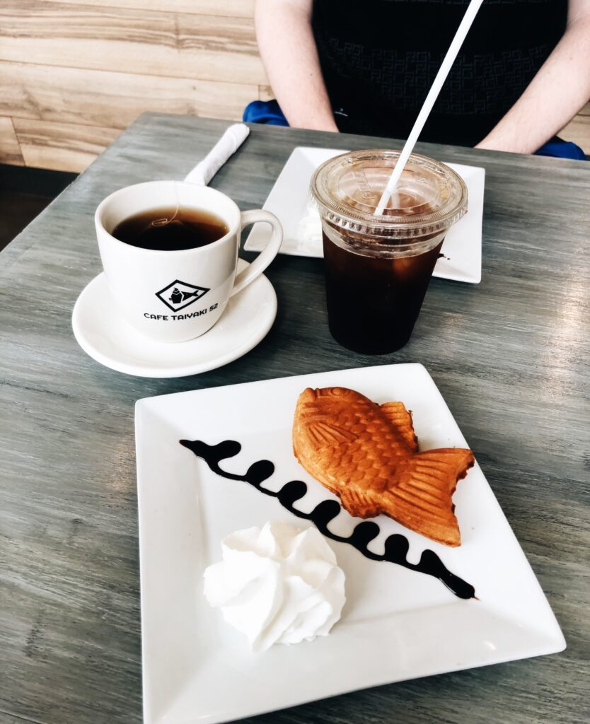 A single Taiyaki pictured with coffee.
