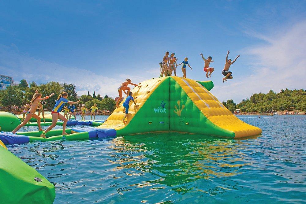 Kids jumping off the Sylvan Lake Aqua Splash