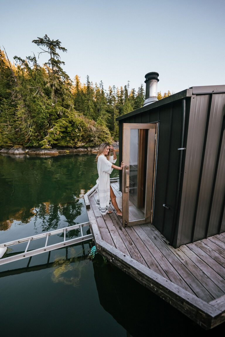 A girl walking into the sauna at the lagoon float camp.
